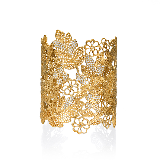 Cuff in 14k yellow gold with 1 cts. t.w. diamonds, $13,000; Marika Desert Gold for H. Weiss