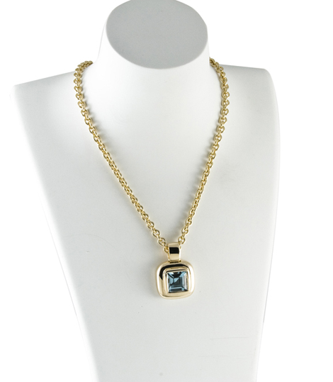 Pendant necklace in 14k gold with London Blue topaz by Zina Sterling