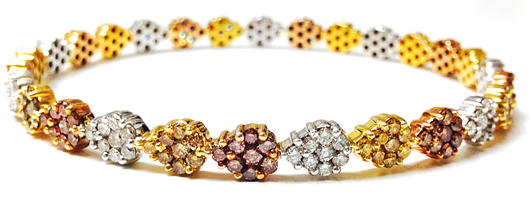 Bangle in 18k gold with natural-color diamonds by Vivaan Jewels