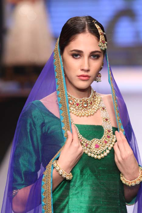 A model glistens in green at the Shobha Shrinagar show at the IIJW 2015.jpg