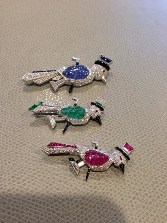 A trio of bird pins from private collections