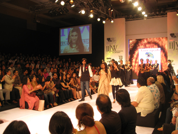 The Amrapali design team joins models on stage after the show.