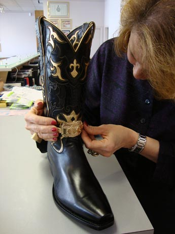Susan Eisen adorns a pair of Tony Lama cowboy boots