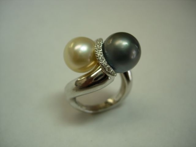 A ring featuring golden and Tahitian pearls