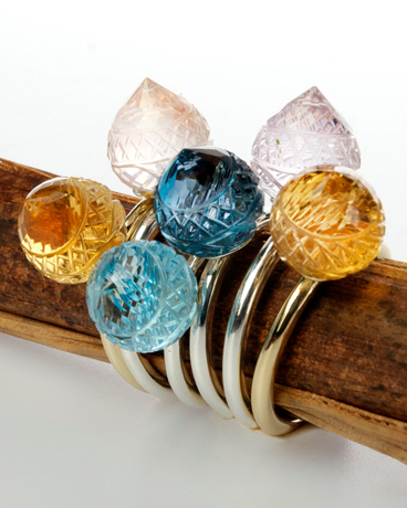 Minaret rings in gold and silver with carved gemstones by Shamila
