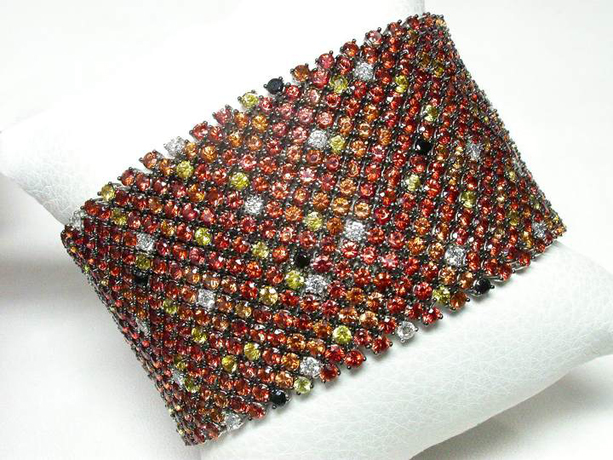 18k gold and orange sapphire mesh bracelet by Laura Beaudry