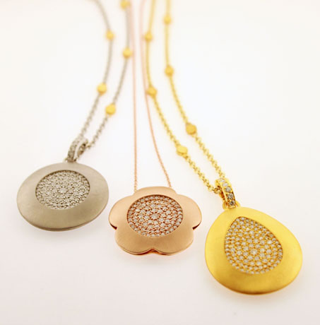 Norman Covan gold and diamond pendants