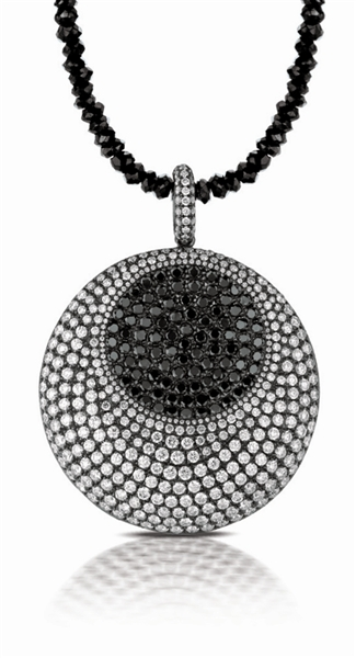 Dove's black white diamond pendant