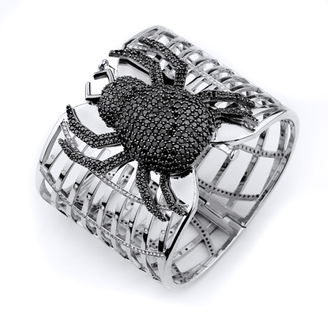 Spider cuff in 14k gold with colorless and black diamonds by J & Y Rocks
