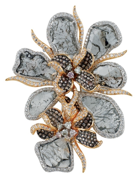 Dynamic International flower brooch