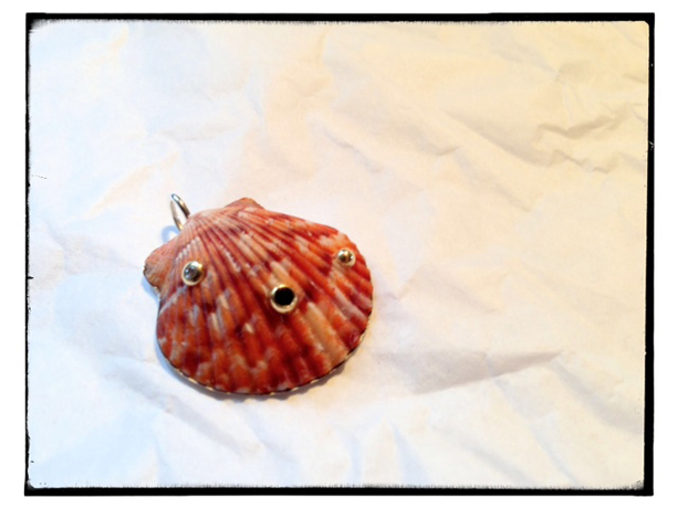 A custom seashell necklace by The Mazza Co.
