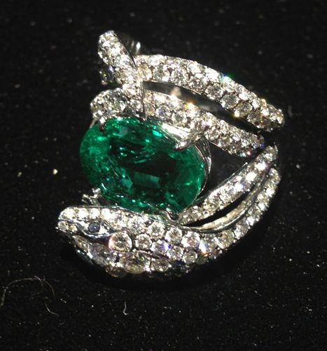One-of-a-kind snake ring in 18k gold with diamonds and emeralds from Stephen Webster