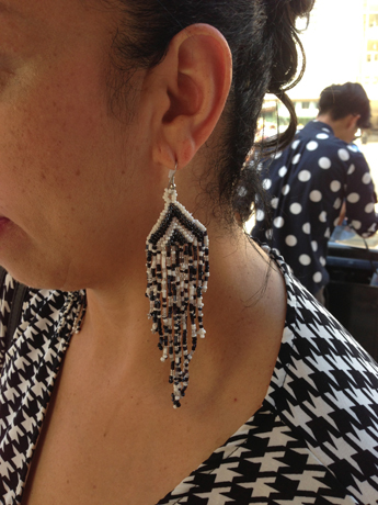 A statement earring style in black and white beads
