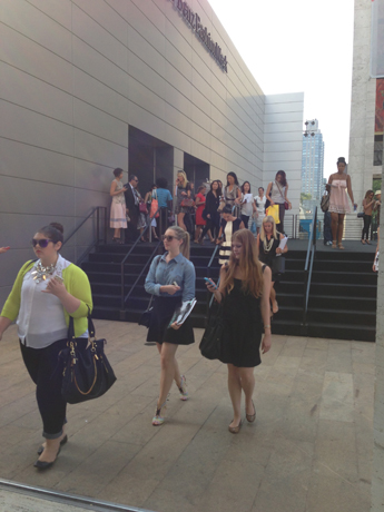 Editors, buyers, bloggers, and other guests stream out of a show on Wednesday afternoon.
