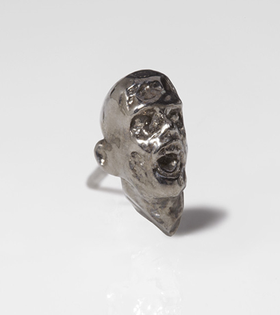 Zombie earring in silver with black rhodium by Slight Jewelry