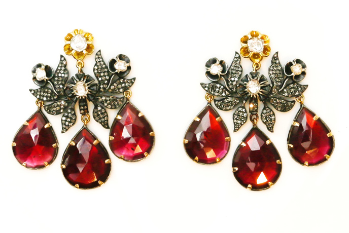 Earring by Jessica Kagan Cushman in oxidized silver with garnets and diamonds