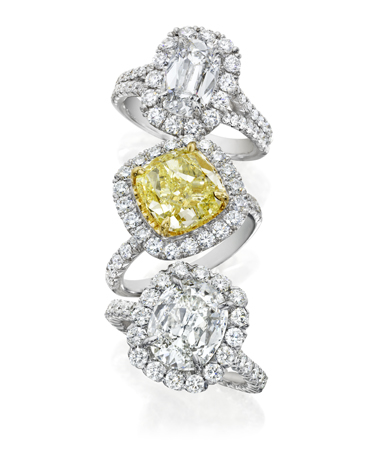 Henri Daussi diamond rings in 18k gold