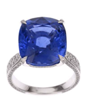 Sapphire and diamond ring from Chopard worn by Debra Messing to the 2014 Emmys