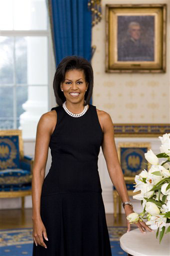First Lady Michelle Obama wearing her signature double-strand pearl necklace.