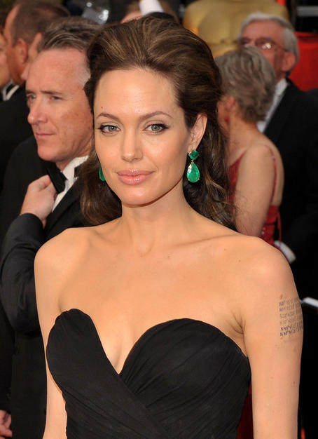 Angelina Jolie in oversize emerald earrings at the 2009 Academy Awards.