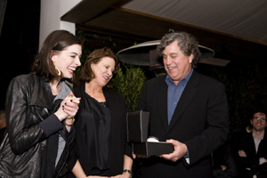From left are Anne Hathaway, Michelle Veyna, and Tom Bernard at Parmigiani pre-Oscar dinner in Los Angeles.