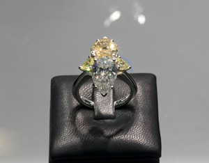 Picchiotti's solitaire engagement ring with a combination of brown, yellow, and white diamonds