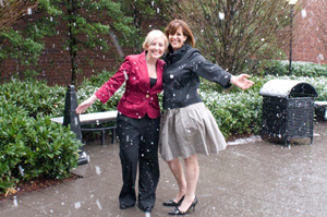 Carol Young (right), executive director of Southern Jewelry Travelers Association, pictured with Libby Brown, SJTA assistant executive director, enjoying the surprise snowfall