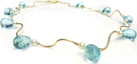 Waves necklace in gold with blue topaz from MIA katrin for Jewel Couture