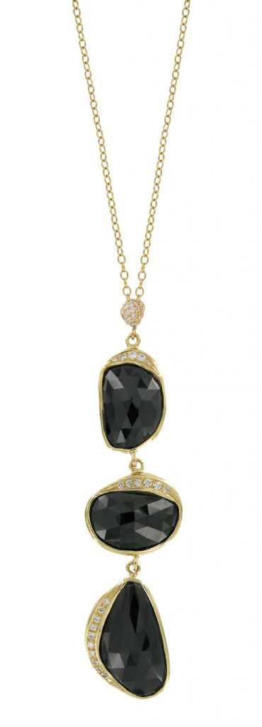 Black spinel, gold, and diamond pendant necklace by Vicente Agor