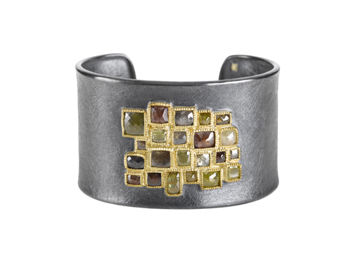 Cuff in sterling silver and 18k yellow gold with 14 cts. t.w. fancy-cut diamonds and a 0.01 ct. t.w. raw diamond cube, $30,030; Todd Reed
